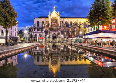Cathedral of Sainte Catherine, reflecting in water, Brussels, Belgium - stock photo