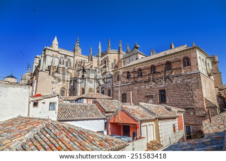 Cathedral of Santa Maria de Toledo from the roofs in Toledo, Spain - stock photo