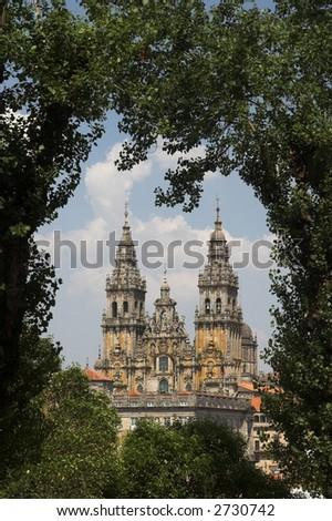 Cathedral of Santiago de Compostela seen through trees. - stock photo