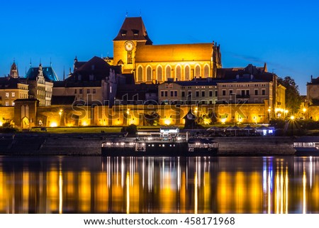 Cathedral of St. John the Baptist and St. John the Evangelist in Torun, Poland at night