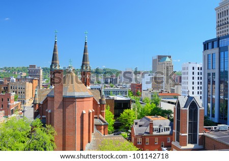 Cathedral of St. Paul amongst the skyline of downtown Birmingham, Alabama, USA. - stock photo