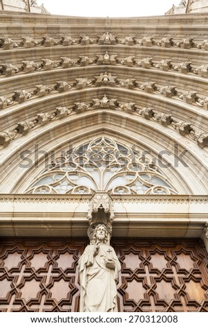 Cathedral of the Holy Cross and Saint Eulalia  Arch of the portal in The Cathedral of the Holy Cross and Saint Eulalia (Barcelona Cathedral) in Barcelona, Spain - stock photo