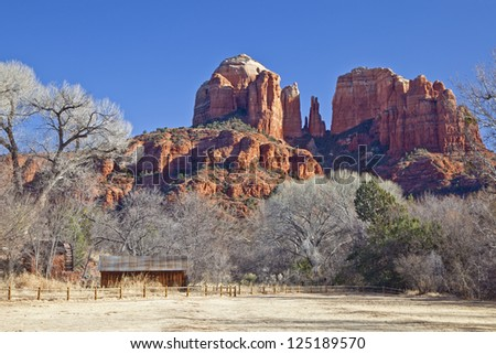 Cathedral Rock in Coconino National Forest in Arizona photographed from  Crescent Moon Ranch State Park on Oak Creek in winter. - stock photo