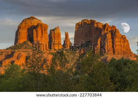 Cathedral Rocks at Sunset with rising moon in Sedona Arizona USA. - stock photo