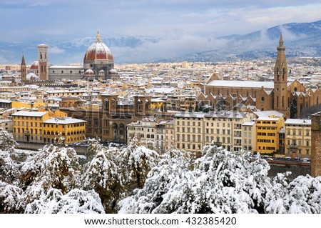 cathedral Santa Maria del Fiore (Duomo) and giottos bell tower (campanile), in winter with snow Florence, Tuscany, Italy - stock photo