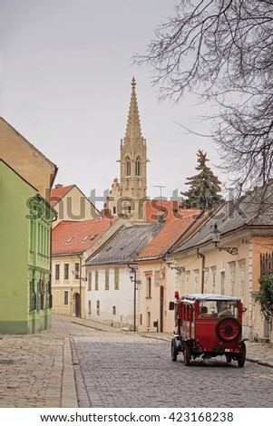 Catholic cathedral and vintage car on old street in Bratislava, Slovakia