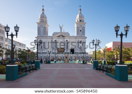 Catholic Cathedral church temple with two large gray towers in blue clear sky in the historic center which is a major tourist attraction.