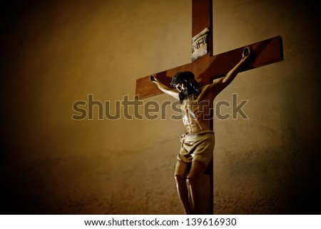 Catholic church and crucifix of Jesus Christ - stock photo