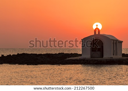 Catholic Church As Silhouette Against The Sunrise In Georgioupolis, Crete, Greece - stock photo