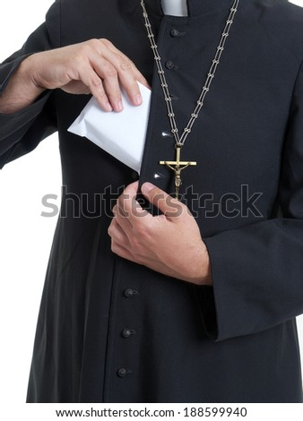 Catholic priest putting thick envelope staffed with bribe money into cassock - stock photo