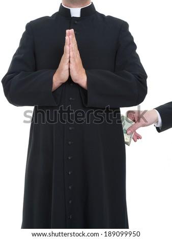 Catholic priest receiving bribe from businessman - stock photo