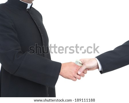 Catholic priest receiving bribe from businessman - stock photo