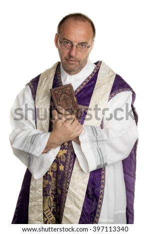 catholic priest with bible in church - stock photo