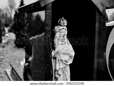 Catholic religious symbols on the Catholic cemeteries in Poland. Artistic look in black and white.