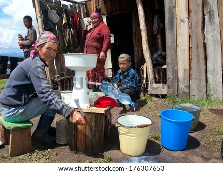 Cattle camp in the mountains of Mongolian Altai. Processing of milk