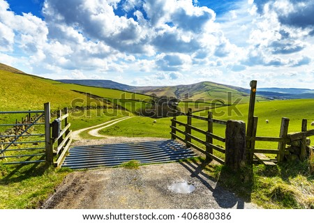Cattle Grid, Stile and Farm Track leading to a farm in the Derbyshire Peak District National Park, near Buxton and Macclesfield, England, UK