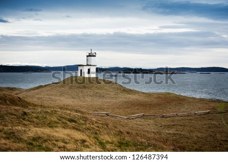 Cattle Point Lighthouse. Poised on a steep wind swept bluff, the Cattle Point Lighthouse marks the southernmost tip of San Juan Island in the Puget Sound area of Washington State. - stock photo