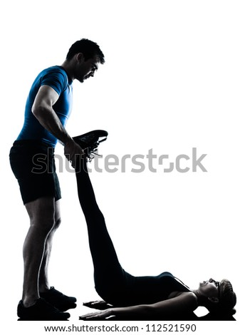 caucasian aerobics instructor  with mature woman exercising fitness workout in silhouette studio isolated on white background - stock photo