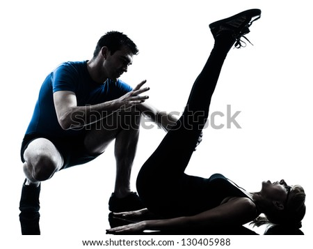 caucasian aerobics instructor  with mature woman exercising fitness workout in silhouette studio isolated on white background