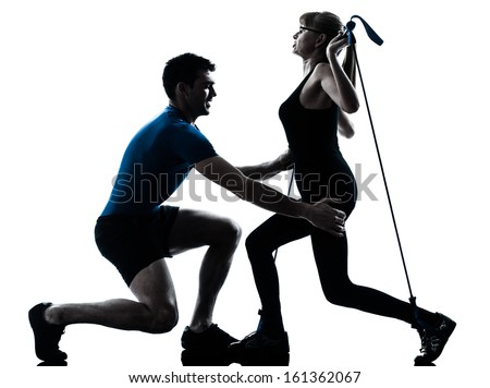 caucasian aerobics instructor  with mature woman exercising gymstick fitness workout in silhouette studio isolated on white background