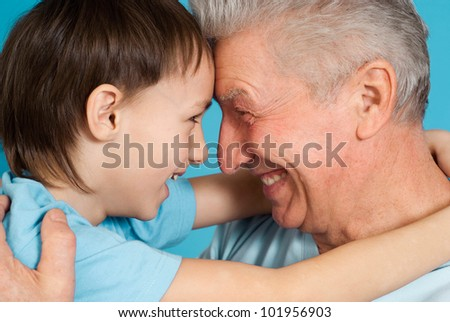 Caucasian aged male with a boy on a blue background
