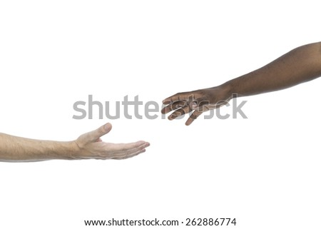 Caucasian and african hands reaching each other on white background - stock photo