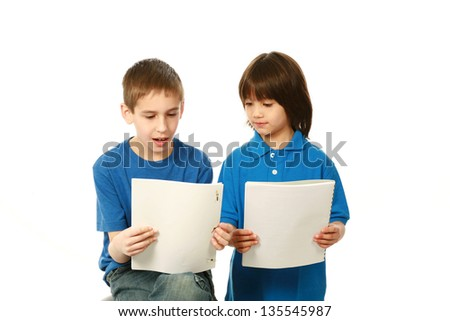 caucasian and asian boys reading scripts