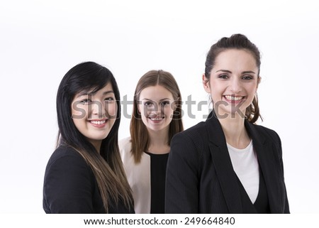 Caucasian and Chinese business women wearing office suits. Isolated on white background.