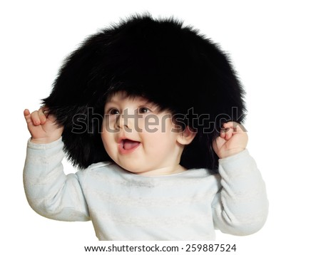 Caucasian baby boy in big black hat isolated on white - stock photo