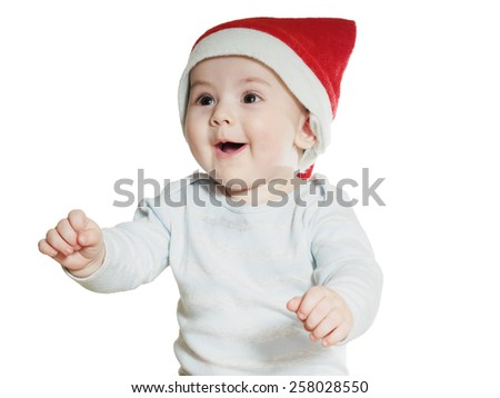 Caucasian baby boy in Christmas hat isolated on white - stock photo