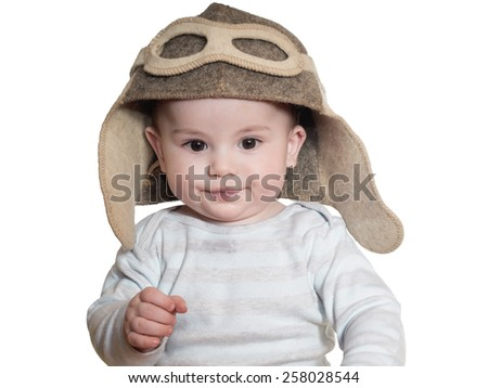 Caucasian baby boy in pilot hat isolated on white - stock photo