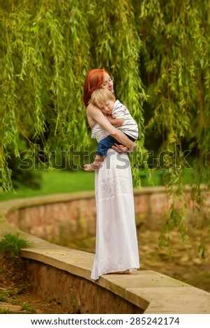 Caucasian baby boy take rest in summer park - stock photo