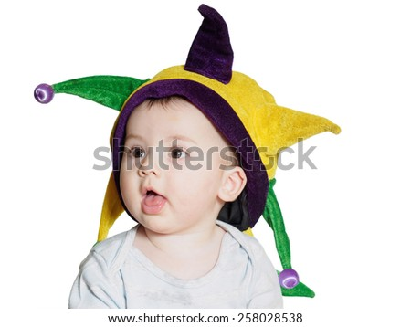 Caucasian baby boy wearing a colored party hat isolated on white