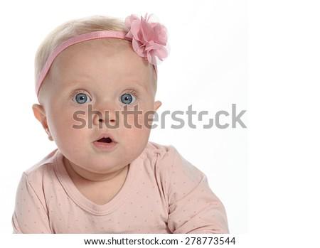 Caucasian baby girl sitting down on white blanket smiling  portrait isolated on white  - stock photo