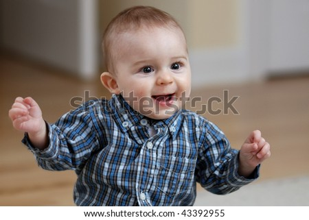 Caucasian baby snapping fingers - stock photo