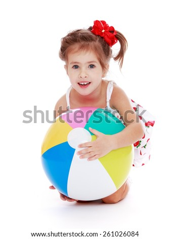 Caucasian beautiful little girl holding a ball - isolated on white. - stock photo
