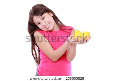 caucasian beautiful little girl with fresh yellow lemons - stock photo