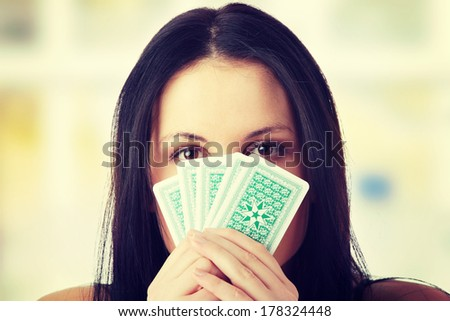 Caucasian beauty playing strip poker