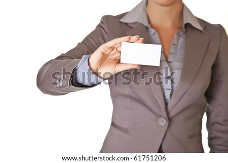 Caucasian blond woman holding blank business card wearing business suit isolated