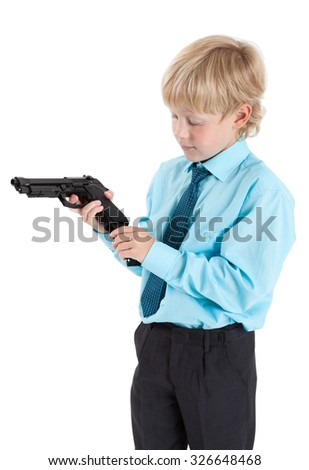 Caucasian boy in shirt with tie charging black gun in hands, isolated on white background - stock photo