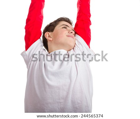 Caucasian boy is stretching raising his arms and hands and looking up - stock photo