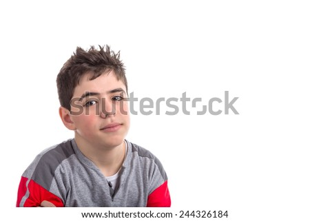 Caucasian boy with big dark eyes and large lips in red and grey pajamas smiles and looks calm and confident - stock photo