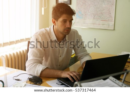Caucasian business man working at his desk.