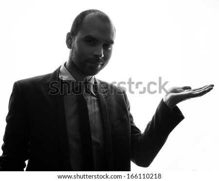 Caucasian businessman silhouette on the white background - stock photo