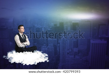 Caucasian businessman sitting on a white fluffy cloud above the city, thinking and wondering
