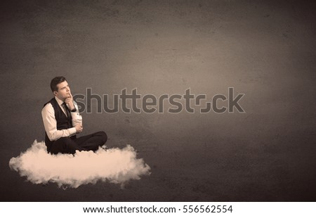 Caucasian businessman sitting on a white fluffy cloud wondering with a plain grunge background