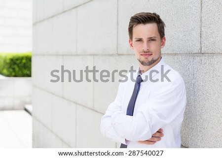 Caucasian businessman standing outside
