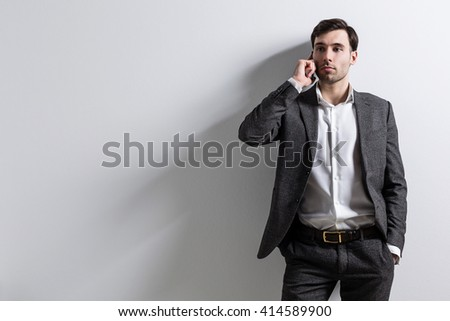 Caucasian businessman talking on the phone on white background. Mock up - stock photo