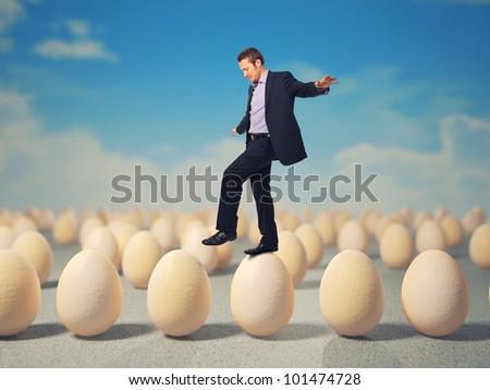caucasian businessman walk on 3d eggs - stock photo