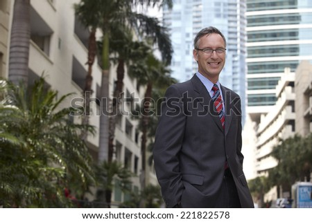 Caucasian businessman with hands in pockets - stock photo
